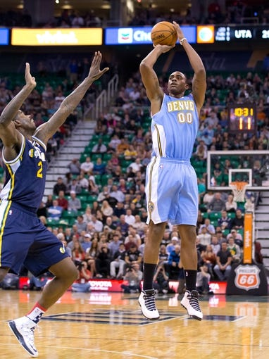 Nov 11, 2013; Salt Lake City, UT, USA; Denver Nuggets power forward Darrell Arthur (00) shoots over Utah Jazz power forward Marvin Williams (2) during the first half at EnergySolutions Arena. Mandatory Credit: Russ Isabella-USA TODAY Sports