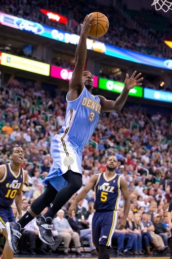 Nov 11, 2013; Salt Lake City, UT, USA; Denver Nuggets point guard Ty Lawson (3) goes to the basket during the first half against the Utah Jazz at EnergySolutions Arena. Mandatory Credit: Russ Isabella-USA TODAY Sports
