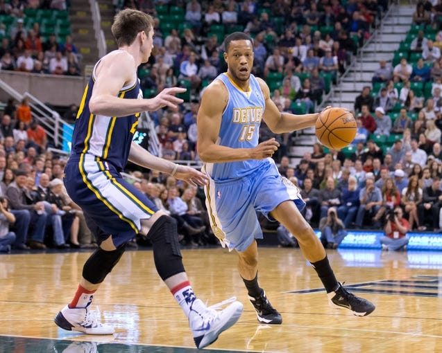 Nov 11, 2013; Salt Lake City, UT, USA; Denver Nuggets small forward Anthony Randolph (15) dribbles while defended by Utah Jazz shooting guard Gordon Hayward (20) during the first half at EnergySolutions Arena. Mandatory Credit: Russ Isabella-USA TODAY Sports