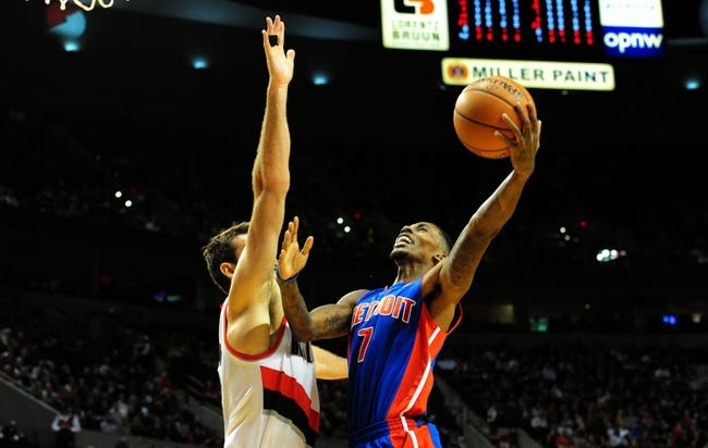 Nov 11, 2013; Portland, OR, USA; Detroit Pistons point guard Brandon Jennings (7) shoots the ball as Portland Trail Blazers center Joel Freeland (19) defends during the first quarter at Moda Center. Mandatory Credit: Steve Dykes - USA TODAY Sports