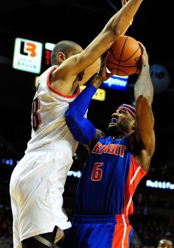 Nov 11, 2013; Portland, OR, USA; Detroit Pistons small forward Josh Smith (6) shoots the ball as Portland Trail Blazers small forward Nicolas Batum (88) defends during the first quarter at Moda Center. Mandatory Credit: Steve Dykes - USA TODAY Sports