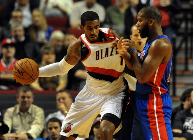 Nov 11, 2013; Portland, OR, USA; Portland Trail Blazers power forward LaMarcus Aldridge (12) battles for the ball with Detroit Pistons center Andre Drummond (0) during the first quarter at Moda Center. Mandatory Credit: Steve Dykes - USA TODAY Sports