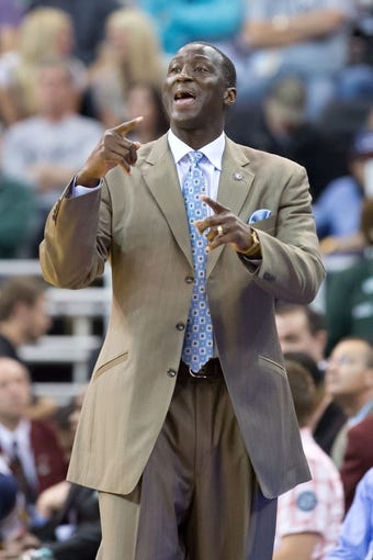 Nov 11, 2013; Salt Lake City, UT, USA; Utah Jazz head coach Tyrone Corbin stands on the sidelines during the second half against the Denver Nuggets at EnergySolutions Arena. Denver won 100-81. Mandatory Credit: Russ Isabella-USA TODAY Sports