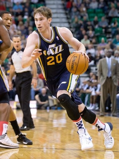 Nov 11, 2013; Salt Lake City, UT, USA; Utah Jazz shooting guard Gordon Hayward (20) dribbles the ball during the second half against the Denver Nuggets at EnergySolutions Arena. Denver won 100-81. Mandatory Credit: Russ Isabella-USA TODAY Sports