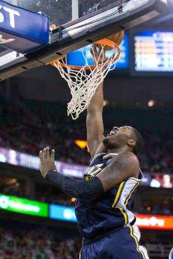 Nov 11, 2013; Salt Lake City, UT, USA; Utah Jazz power forward Derrick Favors (15) shoots the ball during the second half against the Denver Nuggets at EnergySolutions Arena. Denver won 100-81. Mandatory Credit: Russ Isabella-USA TODAY Sports