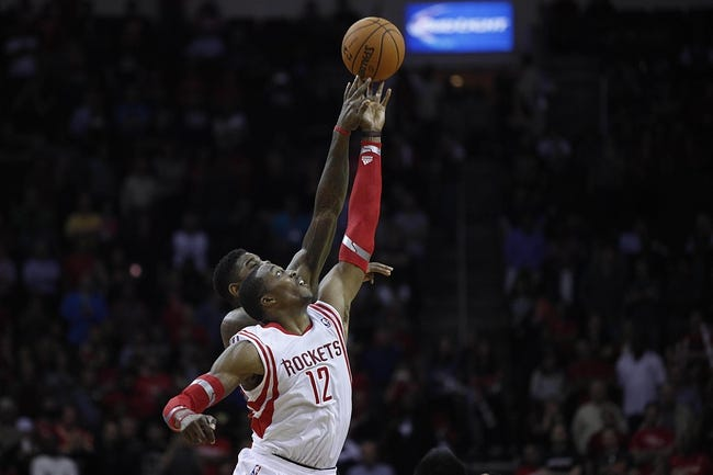 Nov 11, 2013; Houston, TX, USA; Houston Rockets center Dwight Howard (12) and Toronto Raptors power forward Amir Johnson (15) battle for the ball during the fourth quarter at Toyota Center. The Rockets won 110-104. Mandatory Credit: Andrew Richardson-USA TODAY Sports