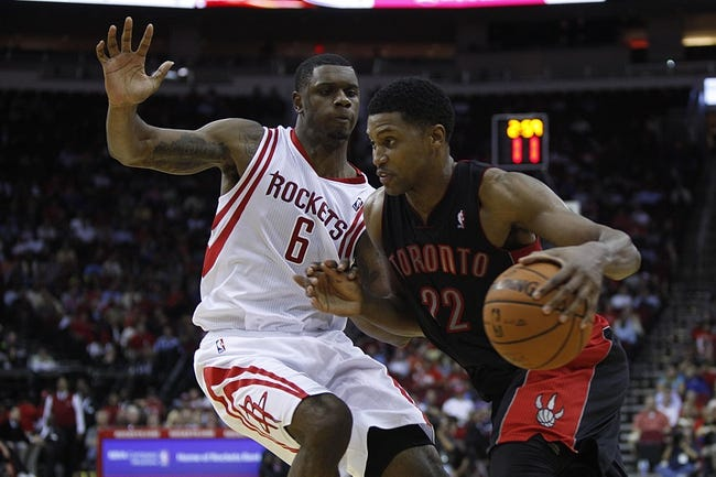 Nov 11, 2013; Houston, TX, USA; Toronto Raptors small forward Rudy Gay (22) dribbles the ball past Houston Rockets power forward Terrence Jones (6) during the fourth quarter at Toyota Center. The Rockets won 110-104.  Mandatory Credit: Andrew Richardson-USA TODAY Sports