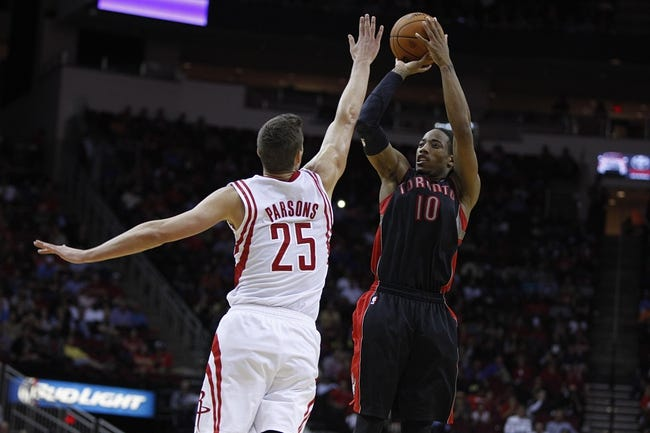 Nov 11, 2013; Houston, TX, USA; Toronto Raptors shooting guard DeMar DeRozan (10) shoots the ball over Houston Rockets small forward Chandler Parsons (25) during the fourth quarter at Toyota Center. The Rockets won 110-104. Mandatory Credit: Andrew Richardson-USA TODAY Sports
