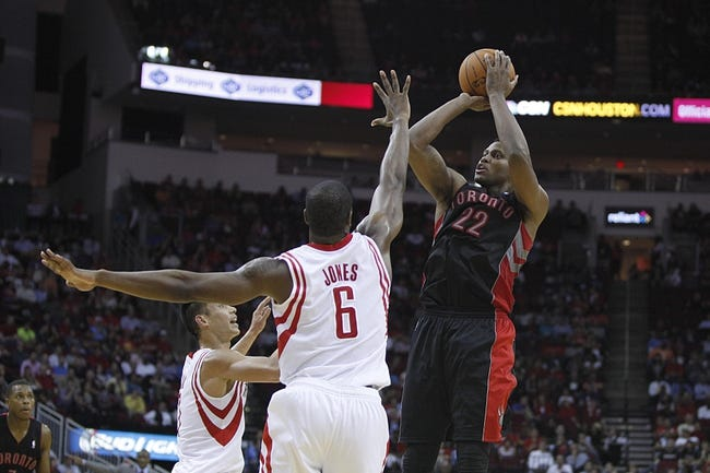 Nov 11, 2013; Houston, TX, USA; Toronto Raptors small forward Rudy Gay (22) shoots the ball over Houston Rockets power forward Terrence Jones (6) during the fourth quarter at Toyota Center. The Rockets won 110-104. Mandatory Credit: Andrew Richardson-USA TODAY Sports