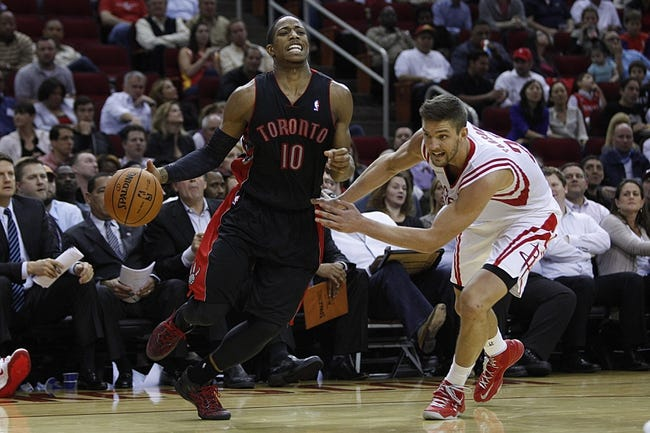 Nov 11, 2013; Houston, TX, USA; Toronto Raptors shooting guard DeMar DeRozan (10) dribbles the ball around Houston Rockets small forward Chandler Parsons (25) during the fourth quarter at Toyota Center. The Rockets won 110-104. Mandatory Credit: Andrew Richardson-USA TODAY Sports