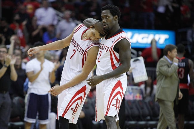 Nov 11, 2013; Houston, TX, USA; Houston Rockets point guard Jeremy Lin (7) and point guard Patrick Beverley (2) walk off the court during the second overtime period at Toyota Center. Mandatory Credit: Andrew Richardson-USA TODAY Sports