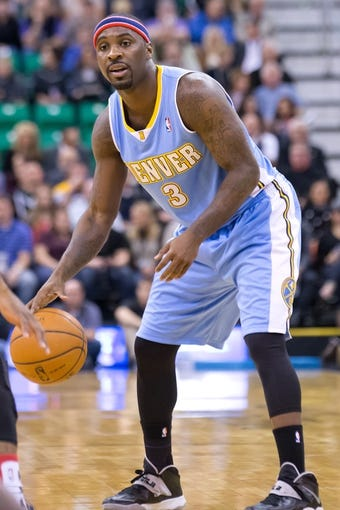 Nov 11, 2013; Salt Lake City, UT, USA; Denver Nuggets point guard Ty Lawson (3) controls the ball during the first half against the Utah Jazz at EnergySolutions Arena. Denver won 100-81. Mandatory Credit: Russ Isabella-USA TODAY Sports