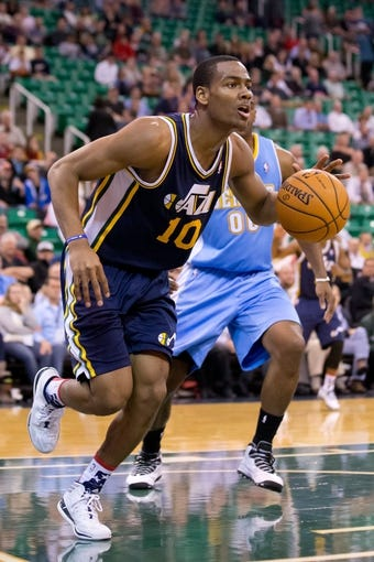 Nov 11, 2013; Salt Lake City, UT, USA; Utah Jazz point guard Alec Burks (10) dribbles during the second half against the Denver Nuggets at EnergySolutions Arena. Denver won 100-81. Mandatory Credit: Russ Isabella-USA TODAY Sports