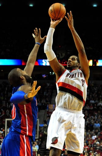 Nov 11, 2013; Portland, OR, USA; Portland Trail Blazers power forward LaMarcus Aldridge (12) shoot over Detroit Pistons power forward Greg Monroe (10) during the third quarter of the game at Moda Center. The Blazers won the game 109-103. Mandatory Credit: Steve Dykes - USA TODAY Sports