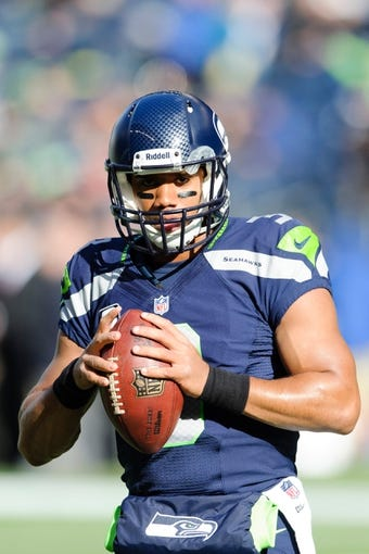 Nov 3, 2013; Seattle, WA, USA; Seattle Seahawks quarterback Russell Wilson (3) during pre game warm ups prior to the game against the Tampa Bay Buccaneers at CenturyLink Field. Seattle defeated Tampa Bay 27-24. Mandatory Credit: Steven Bisig-USA TODAY Sports