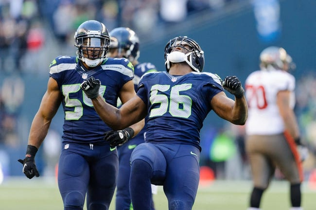 Nov 3, 2013; Seattle, WA, USA; Seattle Seahawks defensive end Cliff Avril (56) celebrates after recording a sack during the game Tampa Bay Buccaneers at CenturyLink Field. Seattle defeated Tampa Bay 27-24. Mandatory Credit: Steven Bisig-USA TODAY Sports