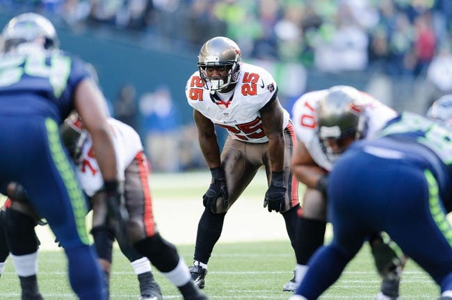 Nov 3, 2013; Seattle, WA, USA; Tampa Bay Buccaneers running back Mike James (25) during the game against the Seattle Seahawks at CenturyLink Field. Seattle defeated Tampa Bay 27-24. Mandatory Credit: Steven Bisig-USA TODAY Sports