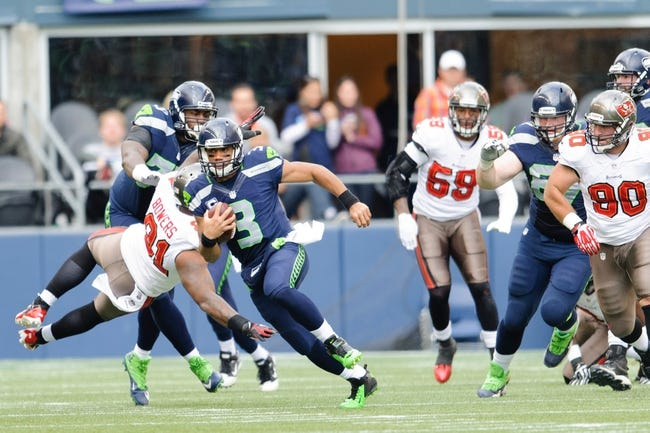Nov 3, 2013; Seattle, WA, USA; Seattle Seahawks quarterback Russell Wilson (3) runs with the ball during the game against the Tampa Bay Buccaneers at CenturyLink Field. Seattle defeated Tampa Bay 27-24. Mandatory Credit: Steven Bisig-USA TODAY Sports