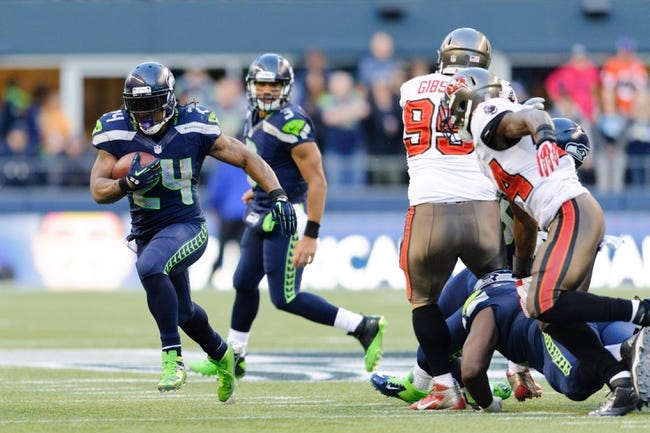Nov 3, 2013; Seattle, WA, USA; Seattle Seahawks running back Marshawn Lynch (24) carries the ball during the game against the Tampa Bay Buccaneers at CenturyLink Field. Seattle defeated Tampa Bay 27-24. Mandatory Credit: Steven Bisig-USA TODAY Sports
