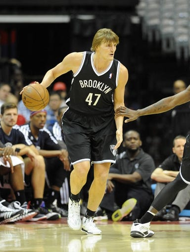 Nov 8, 2013; Washington, DC, USA; Brooklyn Nets small forward Andrei Kirilenko (47) dribbles the ball against the Washington Wizards during the first half at the Verizon Center. Mandatory Credit: Brad Mills-USA TODAY Sports