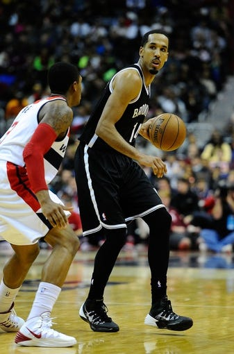 Nov 8, 2013; Washington, DC, USA; Brooklyn Nets point guard Shaun Livingston (14) dribbles the ball as Washington Wizards shooting guard Bradley Beal (3) defends during the second half at the Verizon Center. The Wizards defeated the Nets 112 - 108. Mandatory Credit: Brad Mills-USA TODAY Sports