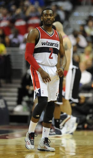 Nov 8, 2013; Washington, DC, USA; Washington Wizards point guard John Wall (2) during the second half against the Brooklyn Nets at the Verizon Center. The Wizards defeated the Nets 112 - 108. Mandatory Credit: Brad Mills-USA TODAY Sports