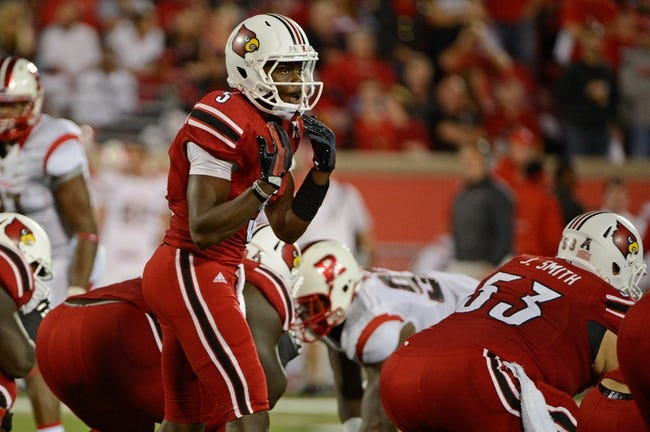 Oct 10, 2013; Louisville, KY, USA; Louisville Cardinals quarterback Teddy Bridgewater (5) adjusts a play at the line of scrimmage during the first quarter of play against the Rutgers Scarlet Knights at Papa John's Cardinal Stadium. Mandatory Credit: Jamie Rhodes-USA TODAY Sports