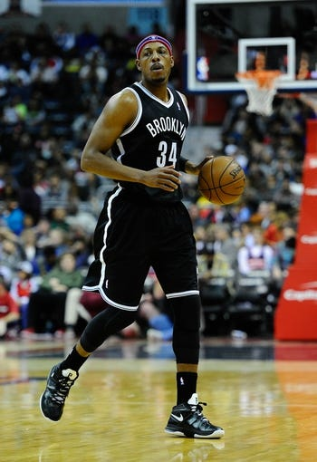 Nov 8, 2013; Washington, DC, USA; Brooklyn Nets small forward Paul Pierce (34) dribbles the ball against the Washington Wizards during the second half at the Verizon Center. The Wizards defeated the Nets 112 - 108. Mandatory Credit: Brad Mills-USA TODAY Sports