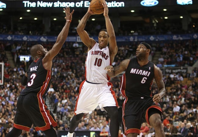 Nov 5, 2013; Toronto, Ontario, CAN; Toronto Raptors guard DeMar DeRozan (10) looks for a play as he is guarded by Miami Heat guard Dwyane Wade (3) and forward LeBron James (6) at Air Canada Centre. The Heat beat the Raptors 104-95. Mandatory Credit: Tom Szczerbowski-USA TODAY Sports