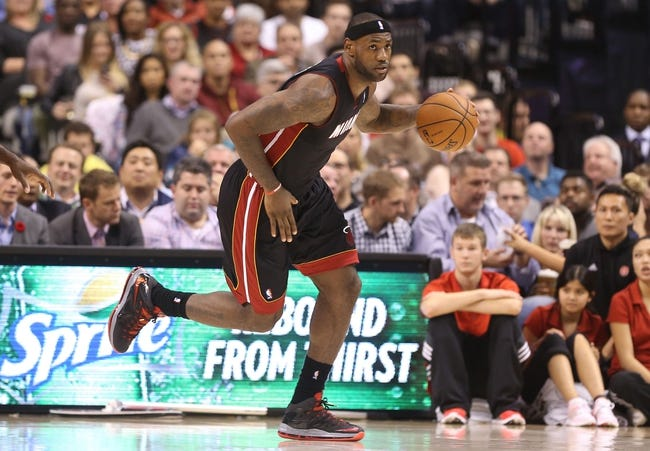 Nov 5, 2013; Toronto, Ontario, CAN; Miami Heat forward LeBron James (6) brings the ball up the court against the Toronto Raptors at Air Canada Centre. The Heat beat the Raptors 104-95. Mandatory Credit: Tom Szczerbowski-USA TODAY Sports