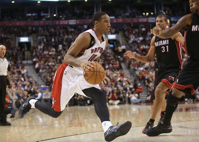 Nov 5, 2013; Toronto, Ontario, CAN; Toronto Raptors guard DeMar DeRozan (10) dribbles the ball as he makes a move against the Miami Heat at Air Canada Centre. The Heat beat the Raptors 104-95. Mandatory Credit: Tom Szczerbowski-USA TODAY Sports
