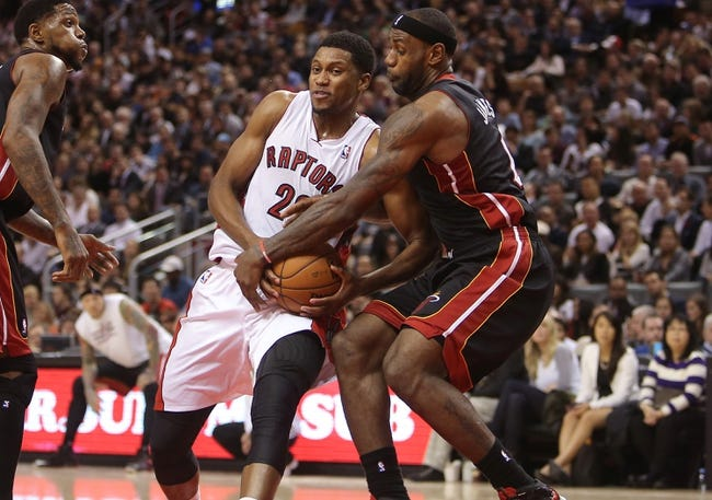 Nov 5, 2013; Toronto, Ontario, CAN; Toronto Raptors forward Rudy Gay (22) goes to the basket against Miami Heat forward LeBron James (6) at Air Canada Centre. The Heat beat the Raptors 104-95. Mandatory Credit: Tom Szczerbowski-USA TODAY Sports