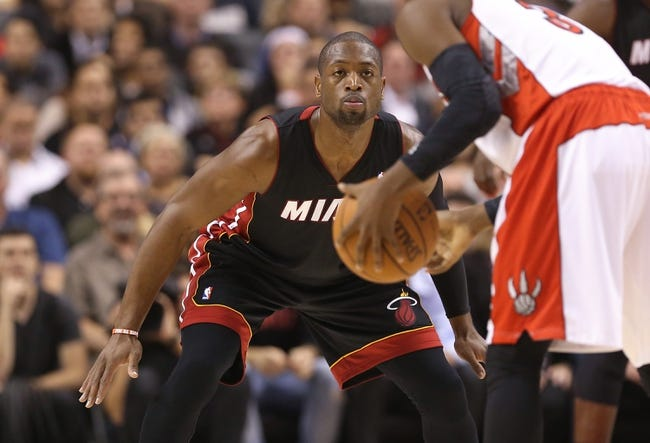 Nov 5, 2013; Toronto, Ontario, CAN; Miami Heat guard Dwyane Wade (3) defends against Toronto Raptors guard Terrence Ross (31) at Air Canada Centre. The Heat beat the Raptors 104-95. Mandatory Credit: Tom Szczerbowski-USA TODAY Sports