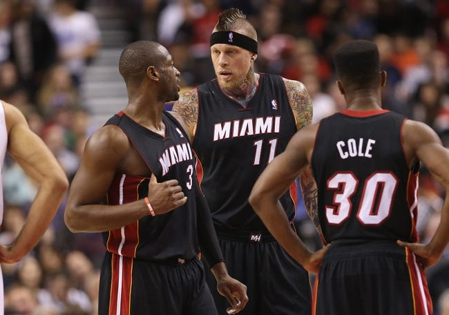 Nov 5, 2013; Toronto, Ontario, CAN; Miami Heat guard Dwyane Wade (3) talks to forward Chris Andersen (11) as point guard Norris Cole (30) looks on against the Toronto Raptors at Air Canada Centre. The Heat beat the Raptors 104-95. Mandatory Credit: Tom Szczerbowski-USA TODAY Sports