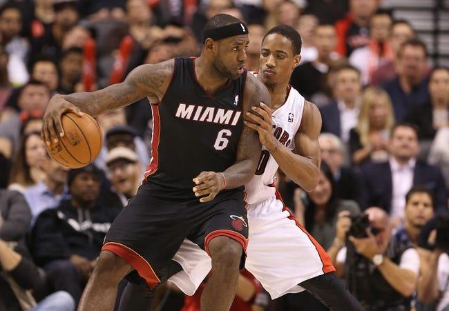 Nov 5, 2013; Toronto, Ontario, CAN; Miami Heat forward LeBron James (6) is guarded by Toronto Raptors guard DeMar DeRozan (10) as he controls the ball at Air Canada Centre. The Heat beat the Raptors 104-95. Mandatory Credit: Tom Szczerbowski-USA TODAY Sports