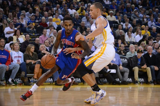 November 12, 2013; Oakland, CA, USA; Detroit Pistons point guard Brandon Jennings (7, left) dribbles the ball against Golden State Warriors point guard Stephen Curry (30, right) during the second quarter at Oracle Arena. Mandatory Credit: Kyle Terada-USA TODAY Sports