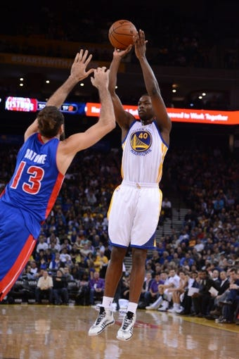 November 12, 2013; Oakland, CA, USA; Golden State Warriors small forward Harrison Barnes (40) shoots the ball against Detroit Pistons small forward Luigi Datome (13) during the third quarter at Oracle Arena. The Warriors defeated the Pistons 113-95. Mandatory Credit: Kyle Terada-USA TODAY Sports