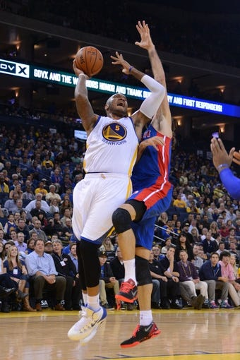 November 12, 2013; Oakland, CA, USA; Golden State Warriors power forward Marreese Speights (5) shoots the ball against the Detroit Pistons during the fourth quarter at Oracle Arena. The Warriors defeated the Pistons 113-95. Mandatory Credit: Kyle Terada-USA TODAY Sports