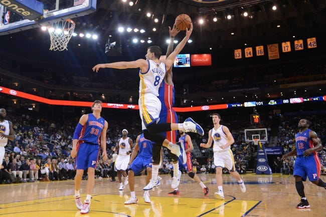 November 12, 2013; Oakland, CA, USA; Golden State Warriors point guard Nemanja Nedovic (8) attempts to dunk the ball against the Detroit Pistons during the fourth quarter at Oracle Arena. The Warriors defeated the Pistons 113-95. Mandatory Credit: Kyle Terada-USA TODAY Sports