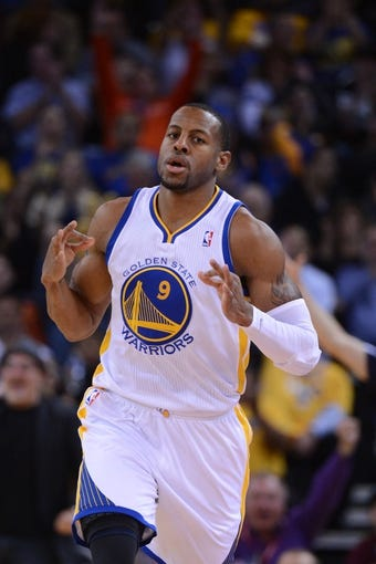 November 12, 2013; Oakland, CA, USA; Golden State Warriors small forward Andre Iguodala (9) celebrates after making a three-point basket against the Detroit Pistons during the first quarter at Oracle Arena. The Warriors defeated the Pistons 113-95. Mandatory Credit: Kyle Terada-USA TODAY Sports