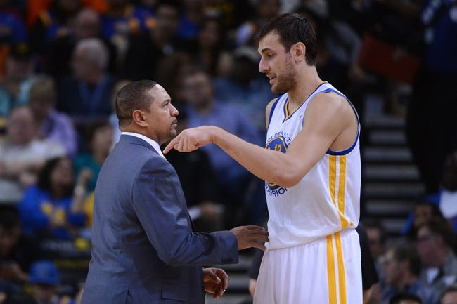 November 12, 2013; Oakland, CA, USA; Golden State Warriors head coach Mark Jackson (left) talks to center Andrew Bogut (12) against the Detroit Pistons during the second quarter at Oracle Arena. The Warriors defeated the Pistons 113-95. Mandatory Credit: Kyle Terada-USA TODAY Sports