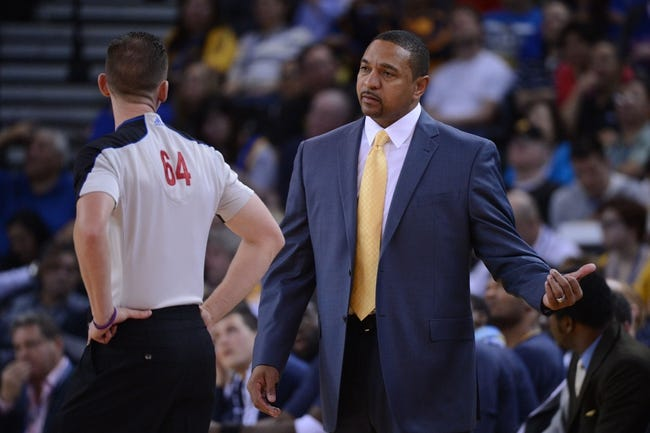November 12, 2013; Oakland, CA, USA; Golden State Warriors head coach Mark Jackson (right) argues with NBA referee Justin Van Duyne (64) during the third quarter against the Detroit Pistons at Oracle Arena. The Warriors defeated the Pistons 113-95. Mandatory Credit: Kyle Terada-USA TODAY Sports