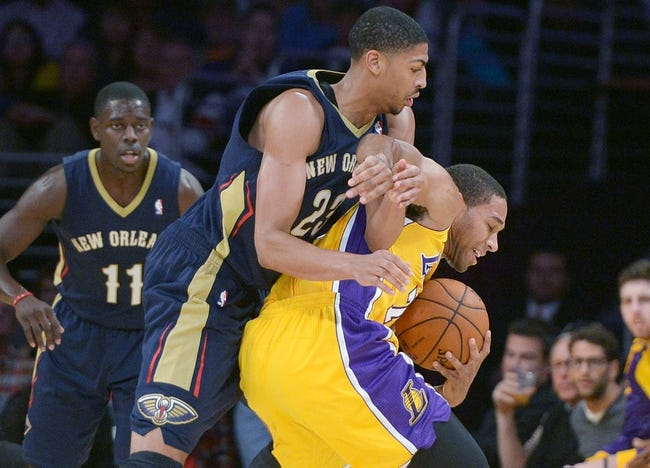Nov 12, 2013; Los Angeles, CA, USA; New Orleans Pelicans forward Anthony Davis (23) defends Los Angeles Lakers forward Xavier Henry (7) at Staples Center. The Lakers defeated the Pelicans 116-95. Mandatory Credit: Kirby Lee-USA TODAY Sports