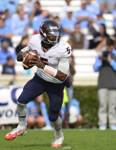 Nov 9, 2013; Chapel Hill, NC, USA; Virginia Cavaliers quarterback David Watford (5) looks to pass in the second quarter at Kenan Memorial Stadium. Mandatory Credit: Bob Donnan-USA TODAY Sports