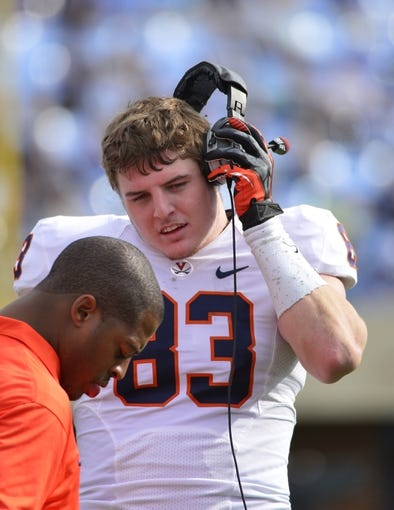 Nov 9, 2013; Chapel Hill, NC, USA; Virginia Cavaliers tight end Jake McGee (83) listens to press box coaches in the second quarter at Kenan Memorial Stadium. Mandatory Credit: Bob Donnan-USA TODAY Sports