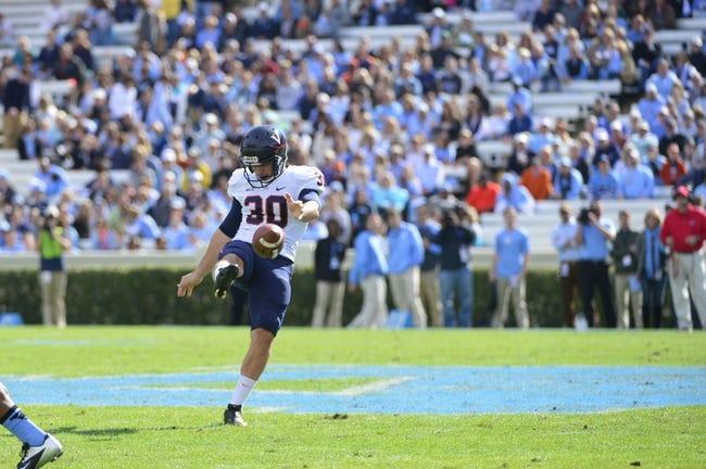 Nov 9, 2013; Chapel Hill, NC, USA; Virginia Cavaliers punter Alec Vozenilek (30) punts in the first quarter at Kenan Memorial Stadium. Mandatory Credit: Bob Donnan-USA TODAY Sports