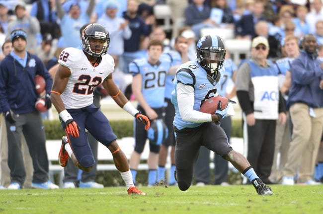 Nov 9, 2013; Chapel Hill, NC, USA; North Carolina Tar Heels wide receiver Sean Tapley (6) with the ball as Virginia Cavaliers cornerback DreQuan Hoskey (22) defends in the third quarter. The Tar Heels defeated the Cavaliers 45-14 at Kenan Memorial Stadium. Mandatory Credit: Bob Donnan-USA TODAY Sports