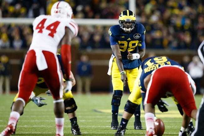 Nov 9, 2013; Ann Arbor, MI, USA; Michigan Wolverines quarterback Devin Gardner (98) gets set to run a play against the Nebraska Cornhuskers at Michigan Stadium. Mandatory Credit: Rick Osentoski-USA TODAY Sports