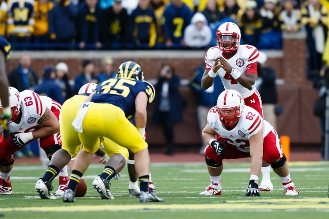 Nov 9, 2013; Ann Arbor, MI, USA; Nebraska Cornhuskers quarterback Tommy Armstrong Jr. (4) gets set to run a play against the Michigan Wolverines at Michigan Stadium. Mandatory Credit: Rick Osentoski-USA TODAY Sports