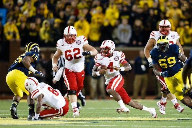 Nov 9, 2013; Ann Arbor, MI, USA; Nebraska Cornhuskers quarterback Tommy Armstrong Jr. (4) runs the ball against the Michigan Wolverines at Michigan Stadium. Mandatory Credit: Rick Osentoski-USA TODAY Sports